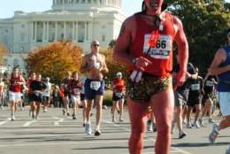 A runner dressed as a devil takes on the National Mall in the 2009 Marine Corps Marathon. (Courtesy Marine Corps Marathon)