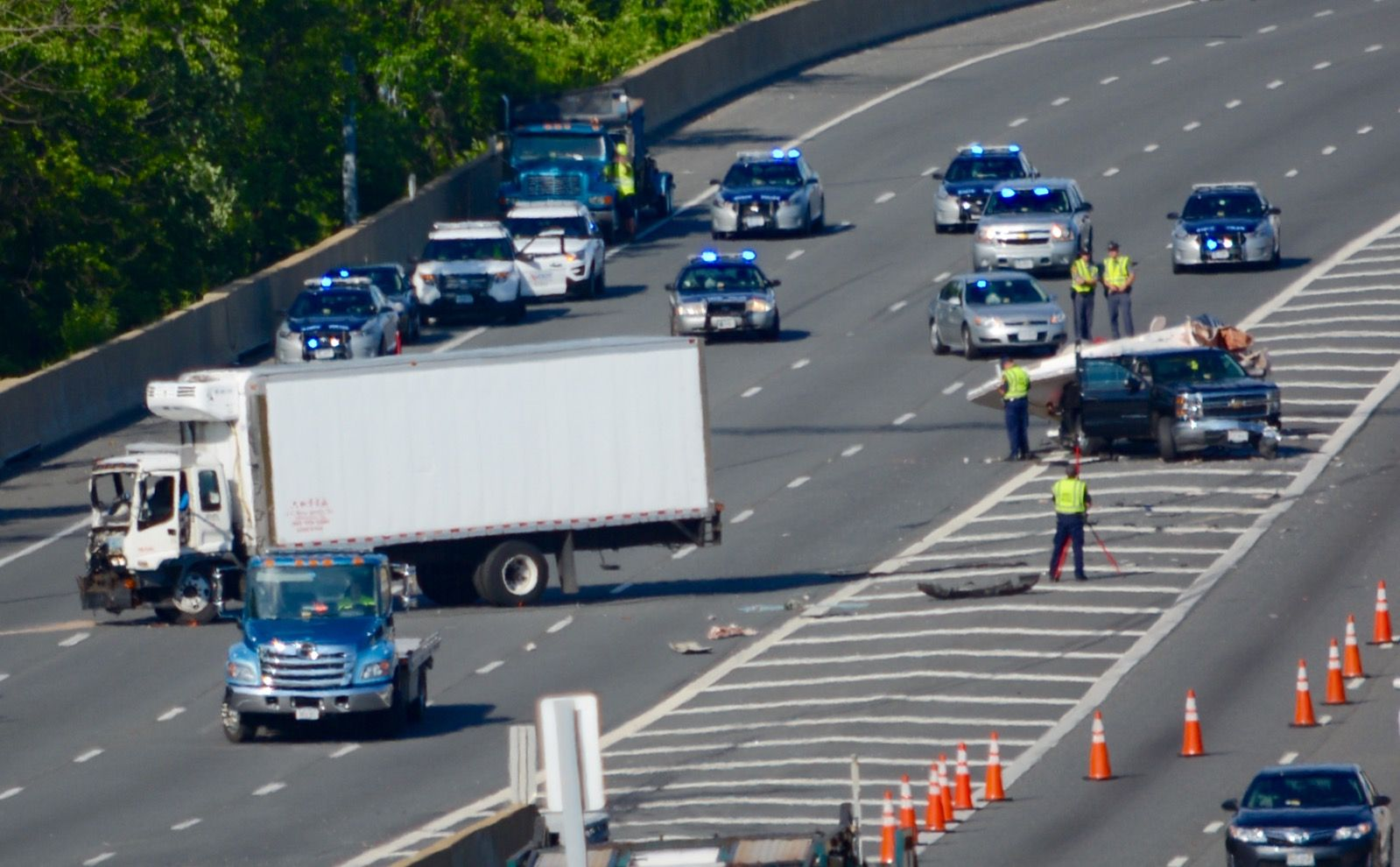 "A spokeswoman for Virginia State police said a pickup truck that was towing a boat had pulled off into the median on westbound Interstate 495, near the portion of the Beltway known as the ""mixing bowl."" (WTOP/Dave Dildine)"
