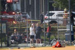 ALEXANDRIA, VA - JUNE 14: Investigators and men dressed in baseball gear gather at Eugene Simpson Field, the site where a gunman opened fire June 14, 2017 in Alexandria, Virginia. Multiple injuries were reported from the instance, the site where a congressional baseball team was holding an early morning practice, including House Republican Whip Steve Scalise (R-LA) who was reportedly shot in the hip. (Photo by Win McNamee/Getty Images)