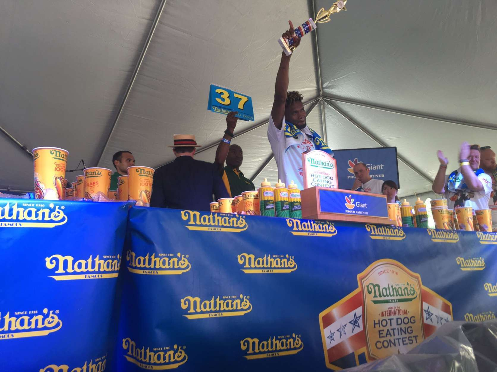 Men's winner Gideon Oji fell one hot dog shy of his personal record of 38, set last year at Coney Island. (WTOP/Noah Frank)