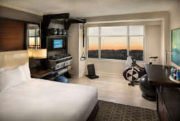 At Hilton McLean Tysons Corner, there's no need to rush down to the gym to squeeze in your morning workout. A handful of rooms in the Northern Virginia hotel come equipped with their own personal gyms— complete with a stationary bike, a meditation chair, a yoga mat and a dynamic GymRax training station for core, strength and high-intensity interval training workouts. (Courtesy Hilton Hotels & Resorts)
