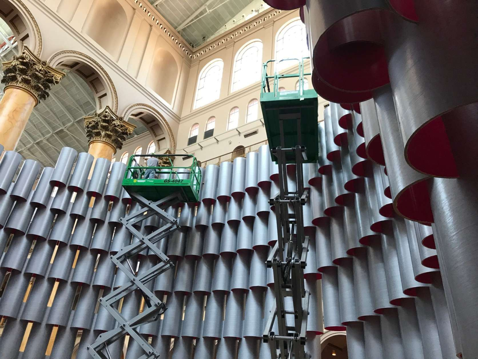 This summer marks the fourth year the museum has commissioned an architect to come up with a themed installation to fill its Great Hall, which is 316 feet by 116 feet and approximately 15 stories tall. The Chicago firm Studio Gang is the mastermind behind Hive.  (WTOP/Rachel Nania)