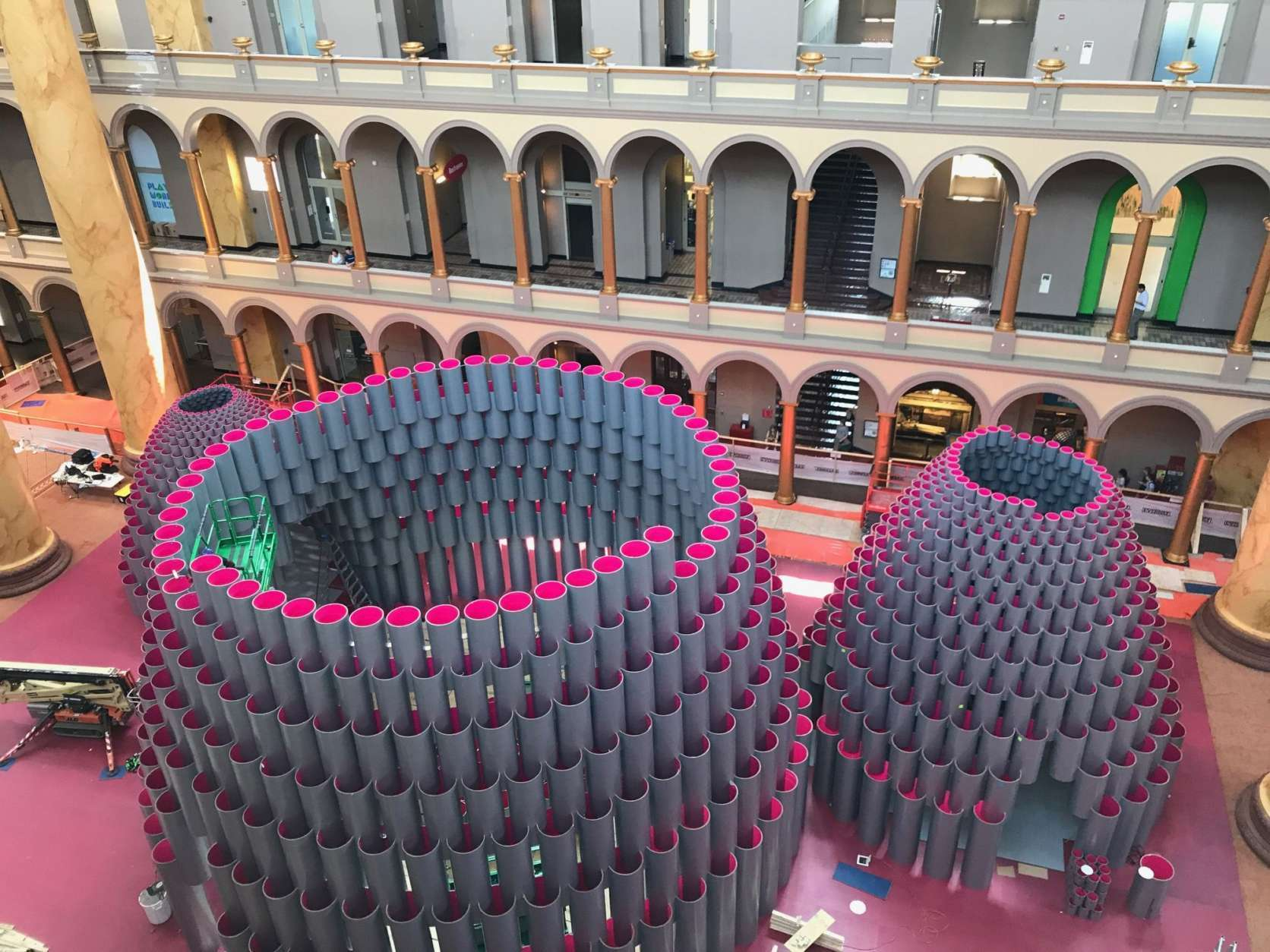 "The National Building Museum is abuzz this week — literally. Architects and construction crews are ""busy as bees"" putting the finishing touches on this year's Summer Block Party exhibit, Hive, which opens July 4. (WTOP/Rachel Nania)"
