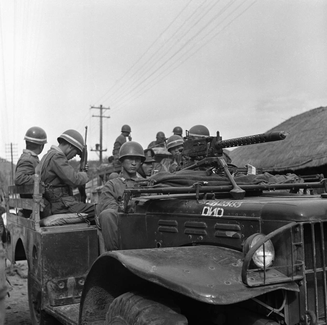South Korean army troops man American built trucks on June 25, 1950, as they defend their country land against Russian invasion. North Korean Communist troops invaded the American sponsored South Korean republic causing an international situation. (AP Phot/T. Lambert )