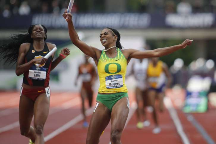 Oregon's Raevyn Rogers celebrates as she crosses the finish line ahead of  Southern California's Kendall Ellis to win the women's 4x400 meters relay  on the ...