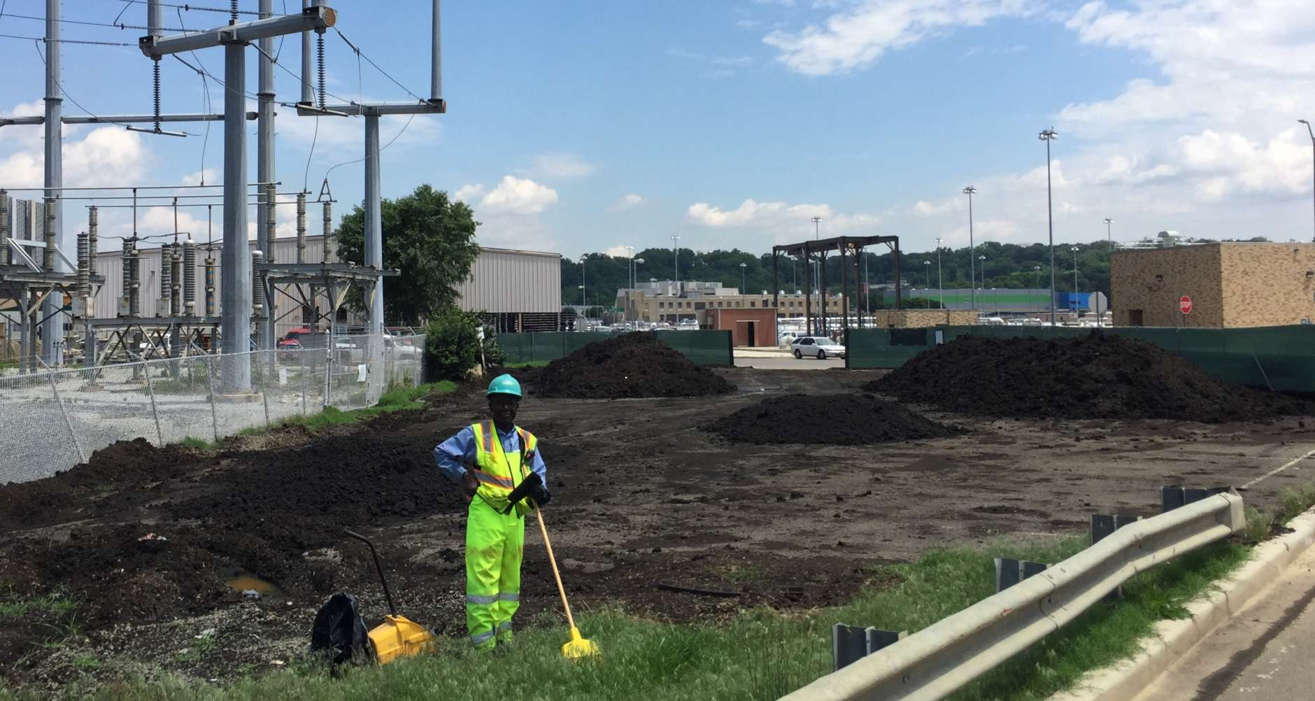 A DC Water employee works in the area where piles of Bloom are curing to remove residual odor and moisture. (WTOP/Kristi King)