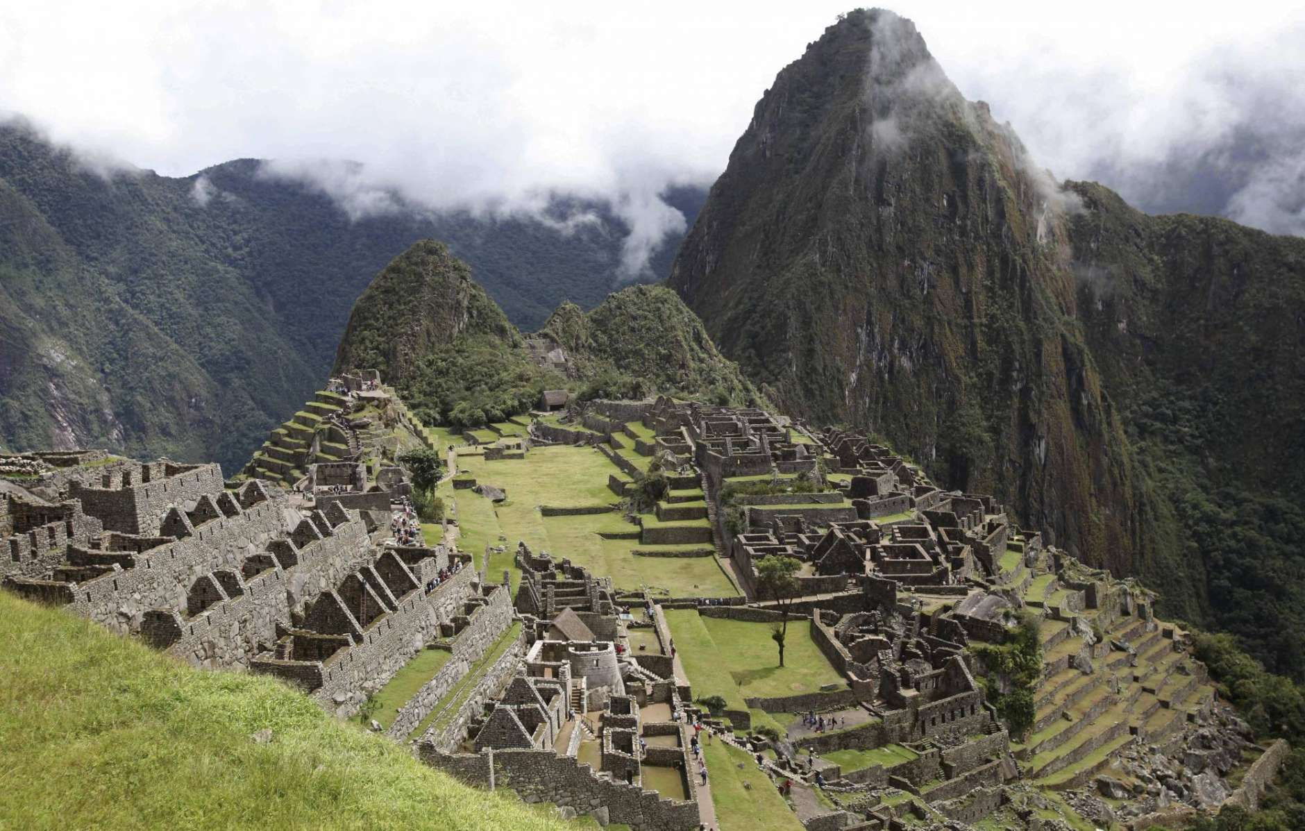 FILE  - In this April 1, 2010 file photo, the citadel of Machu Picchu is seen during its reopening in Cuzco, Peru. Authorities said on Wednesday, June 21 2017, that tourist access to the fabled ruins has be reorganized into two shifts, to help conservations efforts. (AP Photo/Karel Navarro)
