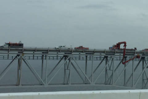 What are those workers on the Bay Bridge doing?