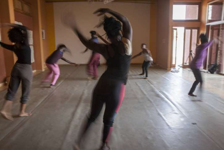 Senegal artist a legend fusing west african modern dance wtop students stretch before rehearsal at the ecole des sables founded by legendary senegalese dancer and choreographer germain acognyin in toubab diallaw fandeluxe Gallery