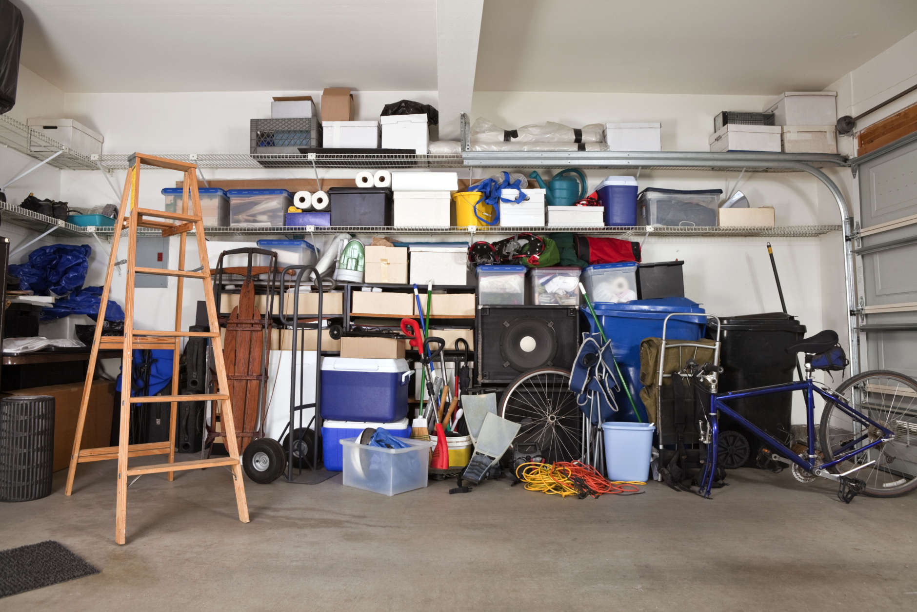No one likes organizing their garage, but installing shelving can make finding things faster and easier. (Thinkstock)