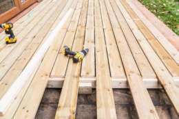 Old, pressure-treated wood in decks contains arsenic and poses a risk to people who touch it with bare feet or hands.  (Thinkstock)