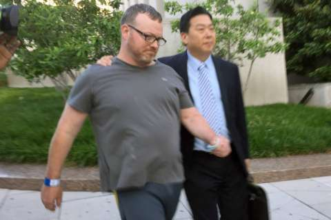 Man who brought guns to Trump Hotel in DC pleads guilty to firearm offense