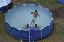 Above-ground pools are an alternative to more costly in-ground pools, but don't necessarily add value to a home. (AP Photo/Martin Mejia)