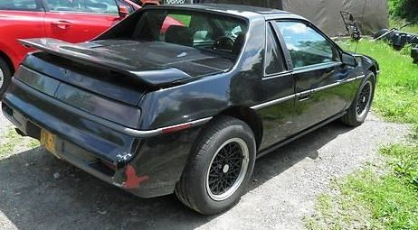 A witness reported seeing a black Pontiac Fiero like this one in the store parking lot about the time of the murder. (Courtesy Montgomery County Police Department)