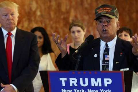 Trump supporter who called for Clinton to be 'shot' attends bill signing