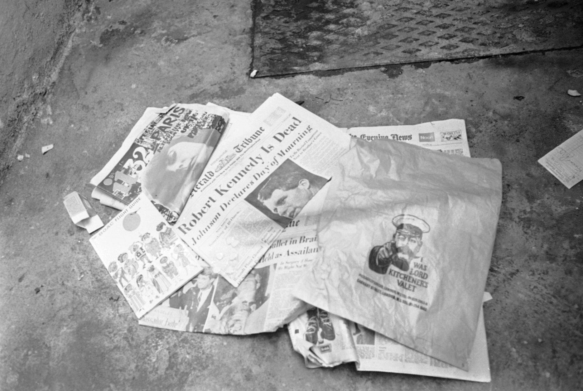 Newspapers, paper bag and an air travel guide which were found in the bed room of the Pax Hotel, where a man identifying himself as Ramon George Sneyd, are lying near a dust bin outside the hotel in Pimlico, London, on June 10, 1968. The proprietor of the hotel, Mrs. Anna Thomas said that Ramon George Sneyd lived in her hotel from June 5 to June 8. Ramon George Sneyd was arrested at London's airport on June 8 for carrying a false passport and a loaded gun. United States Assistant Attorney General is seeking a speedy extradition for the man believed to be James Earl Ray, accused assassin of Dr. Martin Luther King. James Earl Ray had a preliminary hearing in court and was remanded in custody without bail until June 18. (AP Photo/F. Tewkesbury)