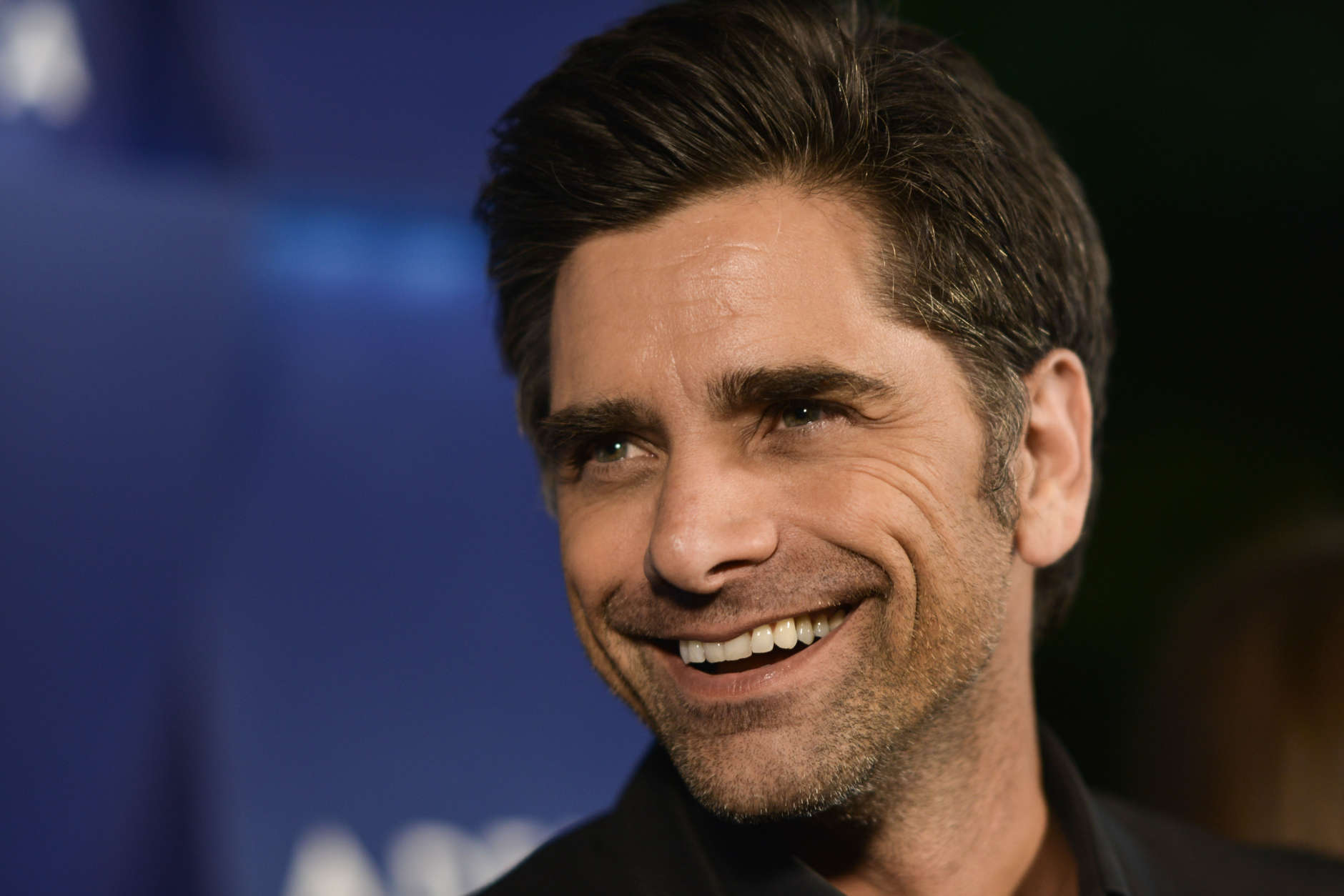 John Stamos arrives at the Delta Airlines' star-studded summer celebration on Thursday, Aug. 15, 2013 in Beverly Hills, Calif. (Photo by Richard Shotwell/Invision/AP)