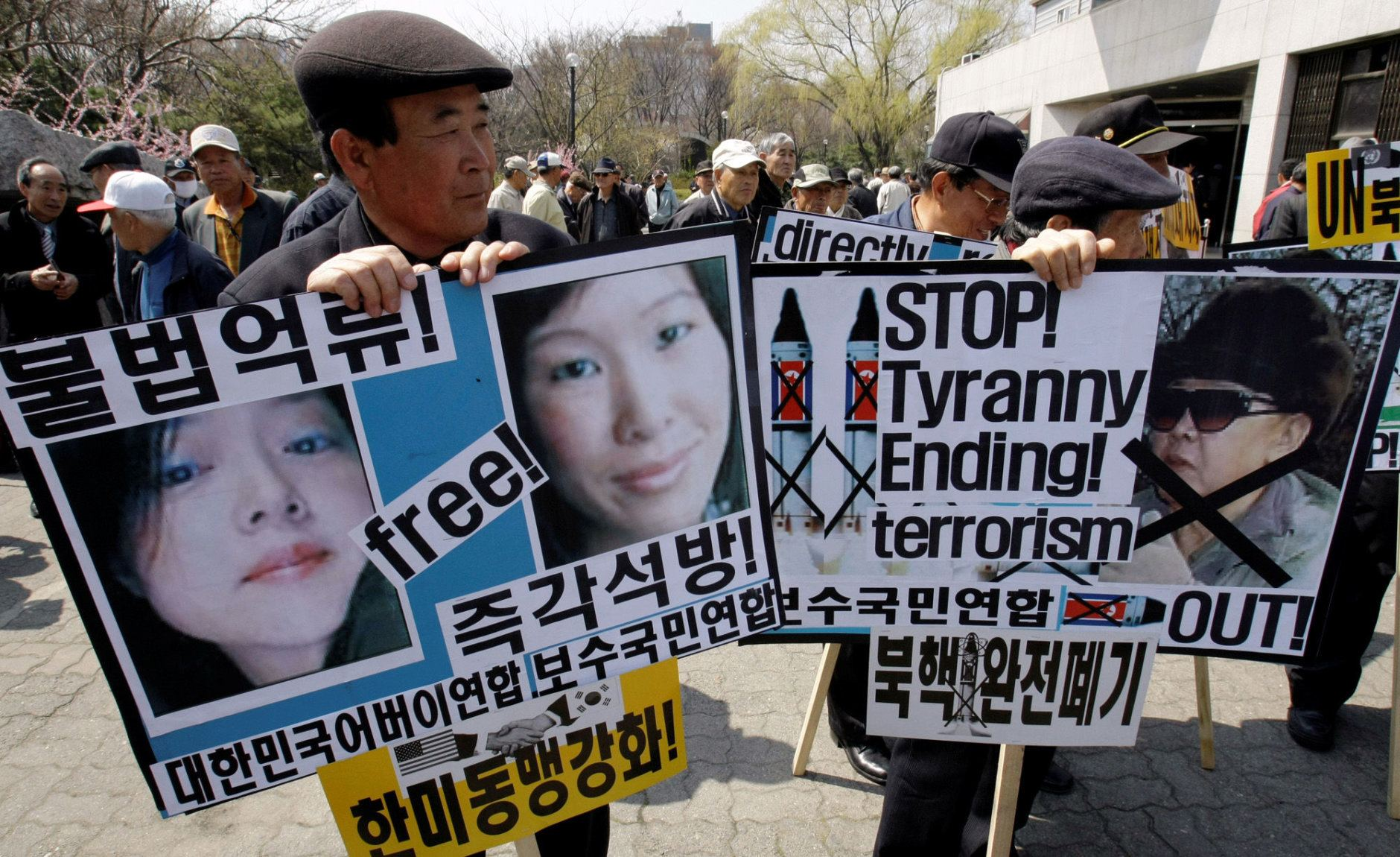 In this photo taken Thursday, April 2, 2009, South Korean protesters hold  pictures of two American journalists Euna Lee, left, Laura Ling, center, and North leader Kim Jong Il, right, during a rally against North Korea in Seoul, South Korea. On Friday, April 24, 2009, North Korea's state news agency said the country has concluded an investigation of two detained American journalists and formally decided to indict them. (AP Photo/ Lee Jin-man)