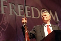 National Rifle Association (NRA) President Charlton Heston holds up a rifle during his address at the 131st NRA convention at the Reno-Sparks Convention Center in Reno, Nevada, April 27, 2002. Heston announced that he would remain president of the NRA for an unprecedented fifth term. (Photo by Candice Towell/Getty Images)