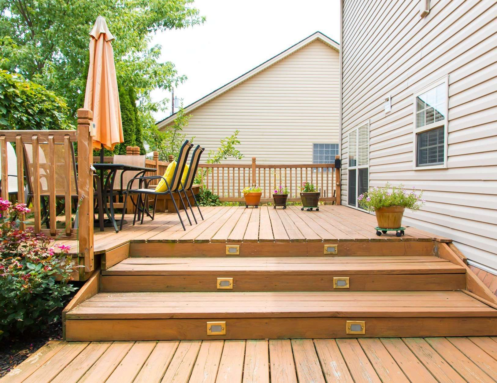 Adding shade to an outdoor seating area can make it more usable during the summer.