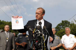 FBI Special Agent in Charge Tim Slater holds up a flyer looking for information about the deceased suspect James T. Hodgkinson, during a media availability Wednesday, June 14, 2017, in Alexandria, Va. A rifle-wielding attacker opened fire on Republican lawmakers as they practiced for a charity baseball game, critically wounding House GOP Whip Steve Scalise of Louisiana and hitting aides and Capitol police as congressmen and others dove for cover.  (AP Photo/Alex Brandon)