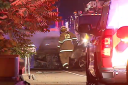 An Emergency Vehicle Moves The Burned Out Wreckage Of A Third Vehicle Involved In The Crash Wtop Dennis Foley