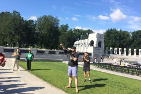 Volunteers beautify WWII Memorial on D-Day anniversary