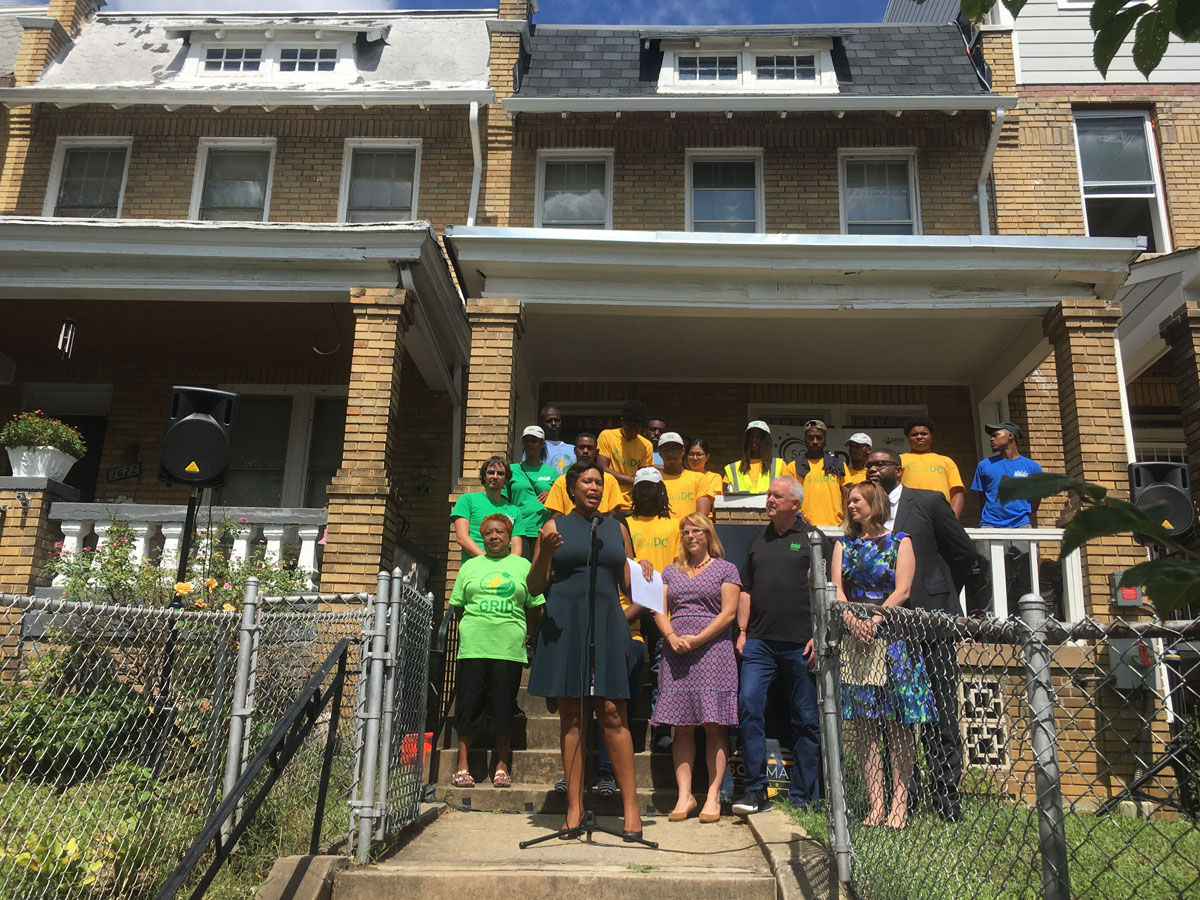 A new program touted by D.C. Mayor Muriel Bowser aims to install solar panels on nearly 300 homes of low-income D.C. families. Leaders say the panels will save the families nearly $600 a year in energy costs. (WTOP/Mike Murillo)