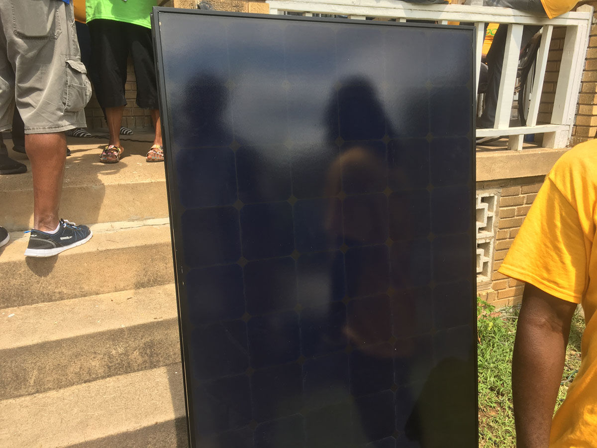 The panels are being installed by the GRID Alternatives program which is a non-profit with a goal of bringing alternative energy sources to low-income families. (WTOP/Mike Murillo)
