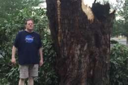 A Queen Anne's County resident stands next to a broken tree after Monday's storm. (Courtesy Angie Chambers Russe)