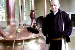 Father Abt of the Notre Dame de Saint Remy, poses at the brewery room in Rochefort, 60 miles south of Brussels, Jan. 24, 2002. The abbey is one of only a half a dozen monasteries where the monks still follow the centuries old Trappist tradition of beer making and its strong, dusky brews are hailed by connoisseurs as some of the world's best. (AP Photo/Yves Logghe)