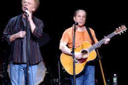 Paul Simon, right, and Art Garfunkel perform at the Fleet Center in Boston, Thursday, Dec. 11, 2003. (AP Photo/Robert E. Klein)
