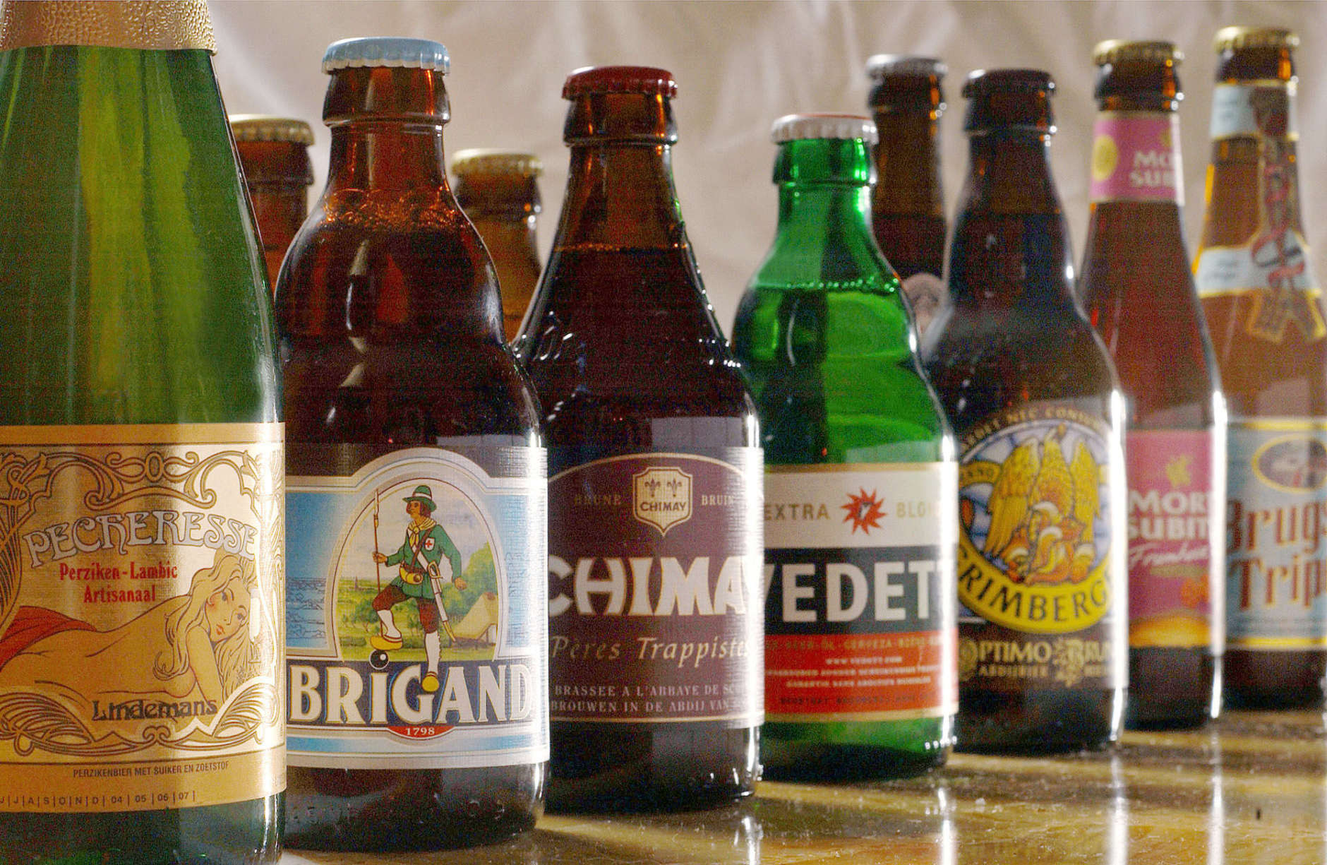 A selection, out of more than 450 types, of beer is shown in Brussels, Belgium, March 10, 2004. Learning the finer points of Belgian beer can be daunting, with types of beer ranging from lambics and fruit lambics, to Trappists and  Gueuze. (AP Photo/Geert Vanden Wijngaert)