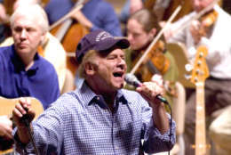 Art Garfunkel rehearses for the opening night concert with the Boston Pops Orchestra at Symphony Hall in Boston, Tuesday, May 11, 2004. Keith Lockhart starts his 10th season as conductor of the Boston Pops on Tuesday night with an assist by Garfunkel at the concert.(AP Photo/ Robert E. Klein)