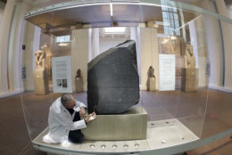 The Rosetta Stone undergoes the last stages of its conservation by Senior Stone Conservator Nic Lee, in the Egyptian Sculpture Gallery at The British Museum, in London, Tuesday July 6, 2004.  According to the museum, the new display will reflect the enduring relevance of the Rosetta Stone as a symbol of human understanding.  The Rosetta Stone is a granite slab dating from 196 BC bearing an inscription that was the key to the deciphering of Egyptian Hieroglyphics, it was found by French troops in 1799 near the town of Rashid (Rosetta) in Lower Egypt. ( Photo / Edmond Terakopian, PA) ** UNITED KINGDOM OUT  NO SALES  MAGS OUT **
