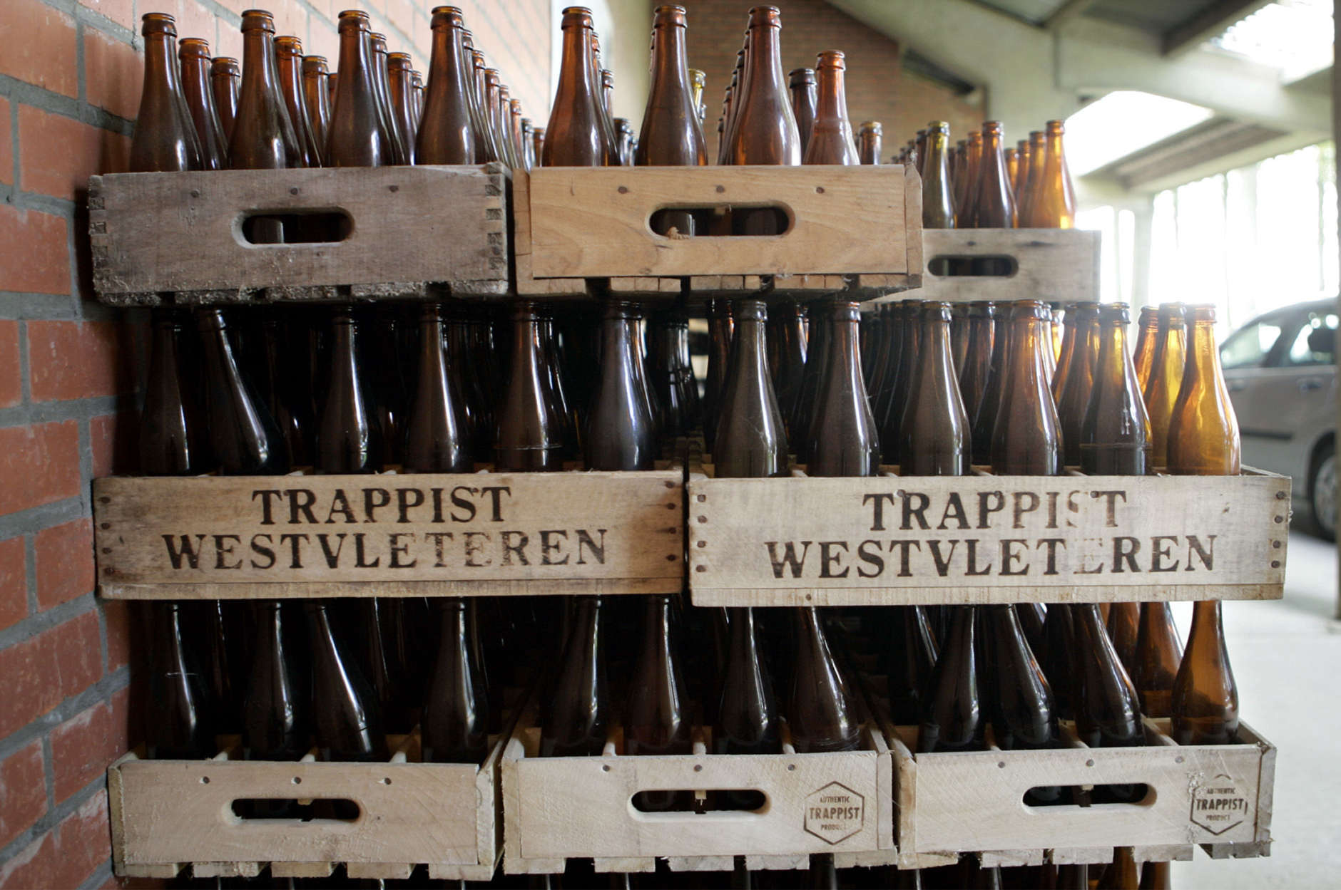 Crates of empty beer bottles are stacked at the Saint Sixtus Abbey in Westvleteren, western Belgium, Tuesday Aug.16, 2005. A website survey of thousands of beer enthusiasts from 65 countries rated the Westvleteren 12 beer as the world's best, forcing the Abbey to stop selling one of its famous beers as it was sold out immediately. The abbey, home to 30 Cistercian and Trappist monks who lead a life of seclusion, prayer, and beer-brewing, doesn't want to raise production as their life in the abbey comes first, not the brewery. (AP Photo/Yves Logghe)