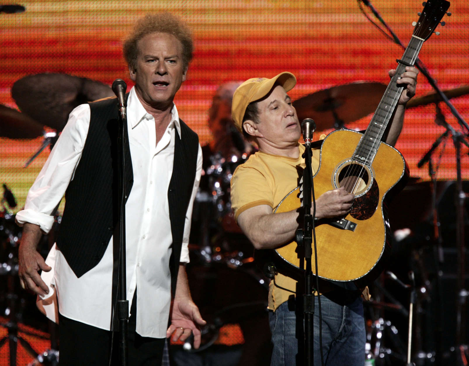 """Art Garfunkel, left, and Paul Simon perform during the """"From the Big Apple to the Big Easy"""" benefit concert, Tuesday, Sept. 20, 2005, in New York's Madison Square Garden. Proceeds from the concert will be donated to Hurricane Katrina relief.  (AP Photo/Jeff Christensen)"""