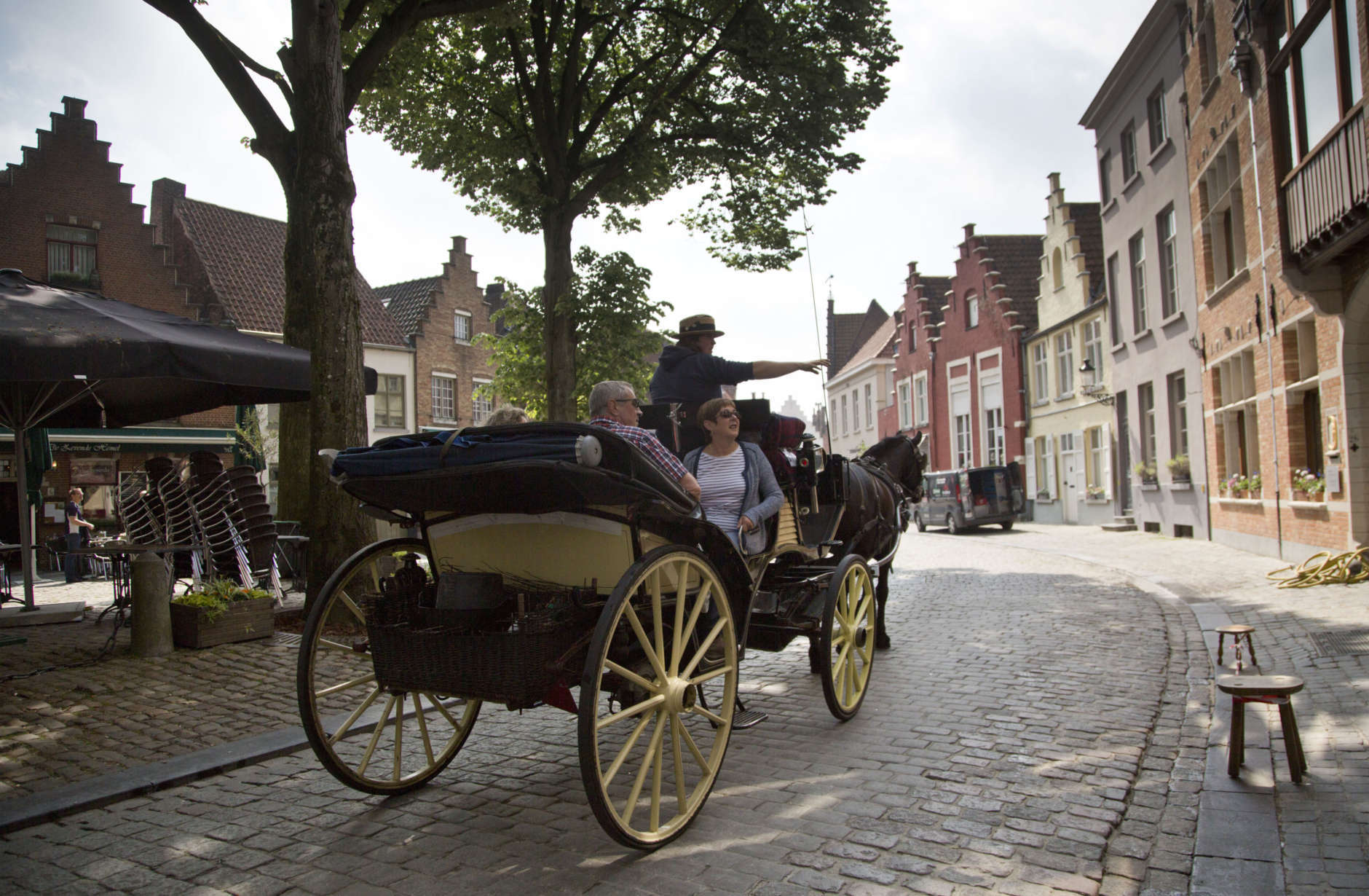 Tourists ride in a horse drawn carriage past the Halve Maan Brewery in Bruges, Belgium on Thursday, May 26, 2016. The brewery has recently created a beer pipeline which will ship beer straight from the brewery to the bottling plant, two kilometers away, through underground pipes running between the two sources. (AP Photo/Virginia Mayo)