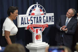 Muriel Bowser, left, Mayor of the District of Columbia, and Rob Manfred, Commissioner of Baseball, right, react at a baseball press conference to unveil the 2018 MLB All-Star Game logo, Wednesday, July 26, 2017, in Washington. (AP Photo/Nick Wass)