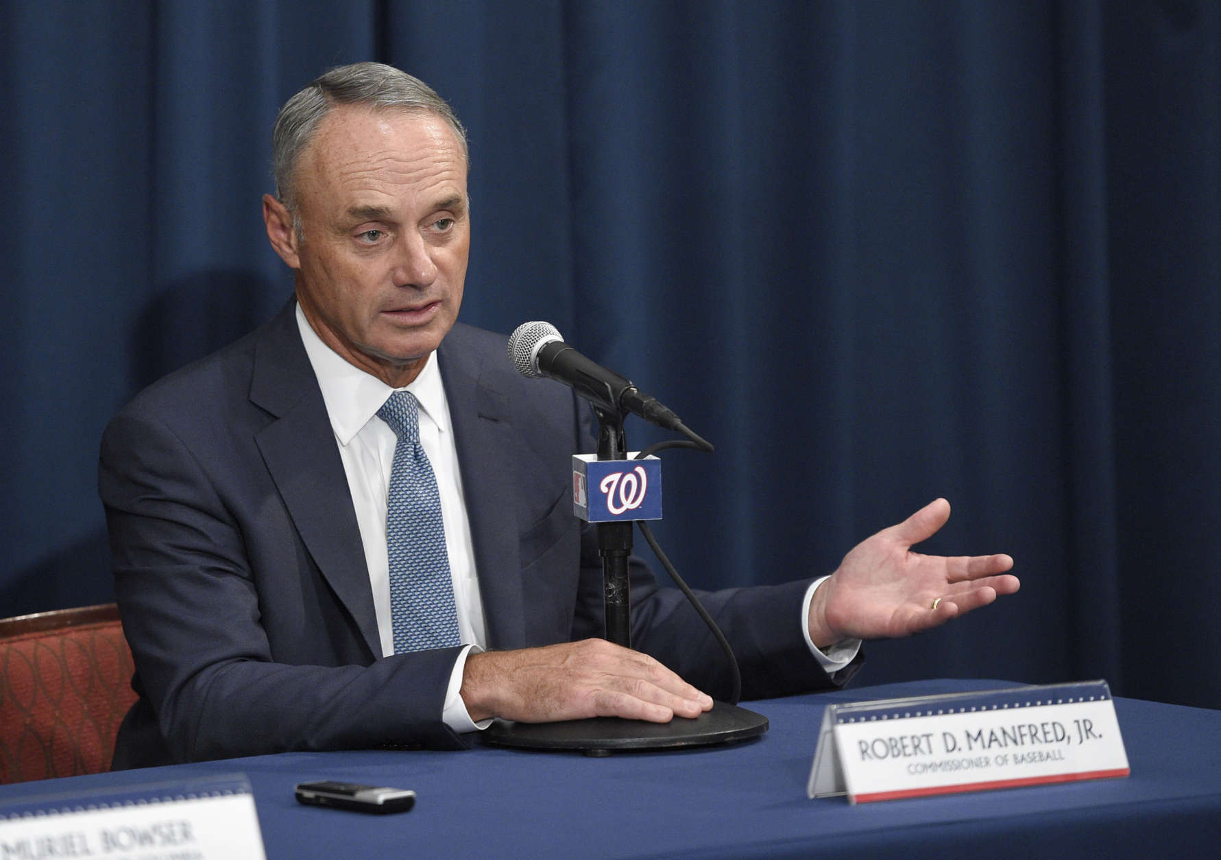 Baseball Commissioner Rob Manfred speaks during a press conference to unveil the 2018 MLB All-Star Game logo, Wednesday, July 26, 2017, in Washington. (AP Photo/Nick Wass)