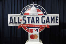 The 2018 MLB All-Star Game logo is displayed after a baseball press conference to unveil the logo, Wednesday, July 26, 2017, in Washington. (AP Photo/Nick Wass)