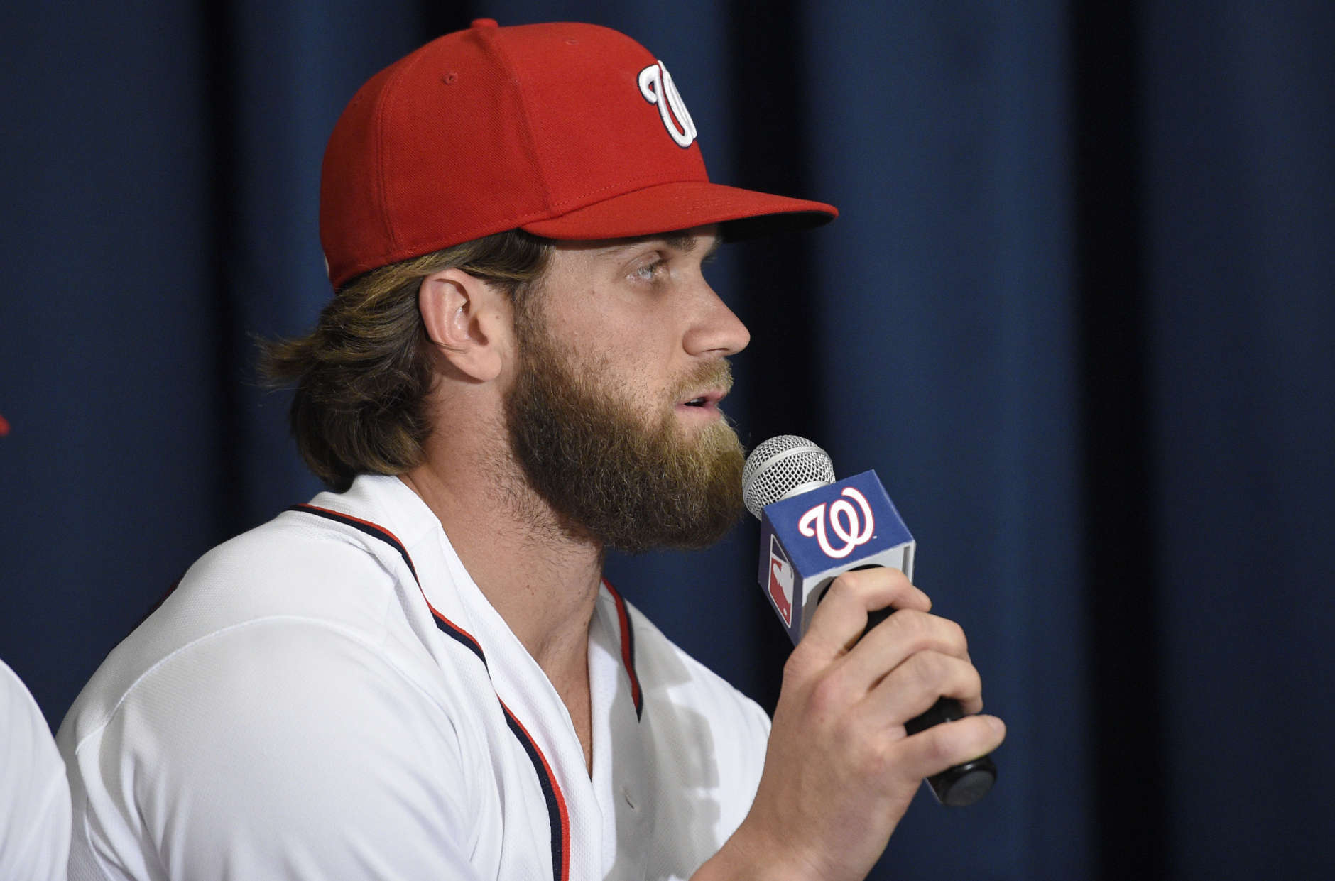 Washington Nationals' Bryce Harper speaks at a baseball press conference to unveil the 2018 MLB All-Star Game logo, Wednesday, July 26, 2017, in Washington. (AP Photo/Nick Wass)