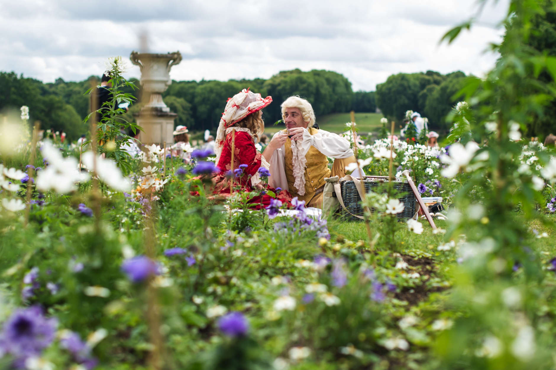 "Visitors Fanny and Patrice wear costumes and lunch in the Vaux-Le-Vicomte castle during the ""Journee Grand Siecle"", the Great Century Day, in Maincy, outside Paris, France, Sunday June 21, 2015. The event aims at recreating King Louis XIV's 17th century atmosphere in the castle and its gardens. (AP Photo/Kamil Zihnioglu)"