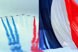 """""""Patrouille de France"""" jet fighters fly blue white and red smoke past a giant French flag over the Champs Elysees in Paris Tuesday July 14 1998 on the occasion of the traditional Bastille day military parade. (AP PHOTO/JeromeDelay)"""
