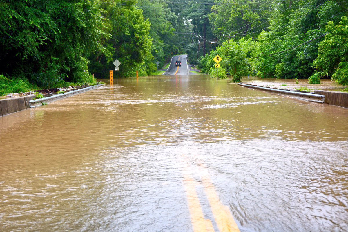 Woodburn Road remains blocked at Accotink Creek in Annandale, Virginia. (WTOP/Dave Dildine)