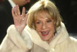FILE - In this Saturday, Dec. 6, 2003 file photo French Actress Jeanne Moreau waves to photographers while on her way to the 16th Annual European Film Awards in Berlin. French actress Jeanne Moreau, whose seven-decade career included work with Francois Truffaut, Orson Welles, Wim Wenders and other acclaimed directors, has died aged 89 it was announced Monday July 31, 2017. (AP Photo/Franka Bruns, File)