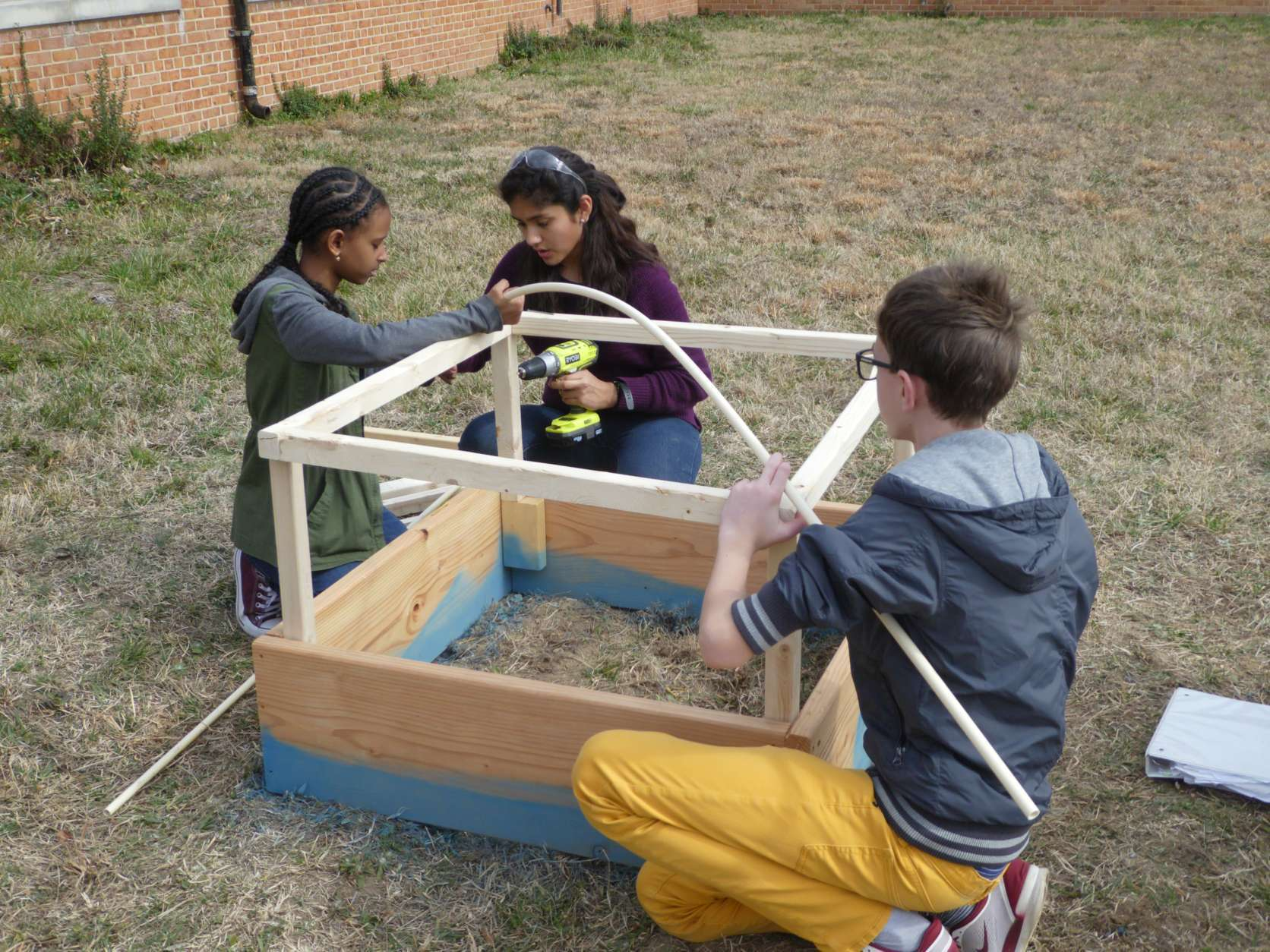 Working on the challenge of solving food insecurity in their community, Edison High students designed and constructed greenhouses and actually grew green peppers. (Courtesy Amol Patel)