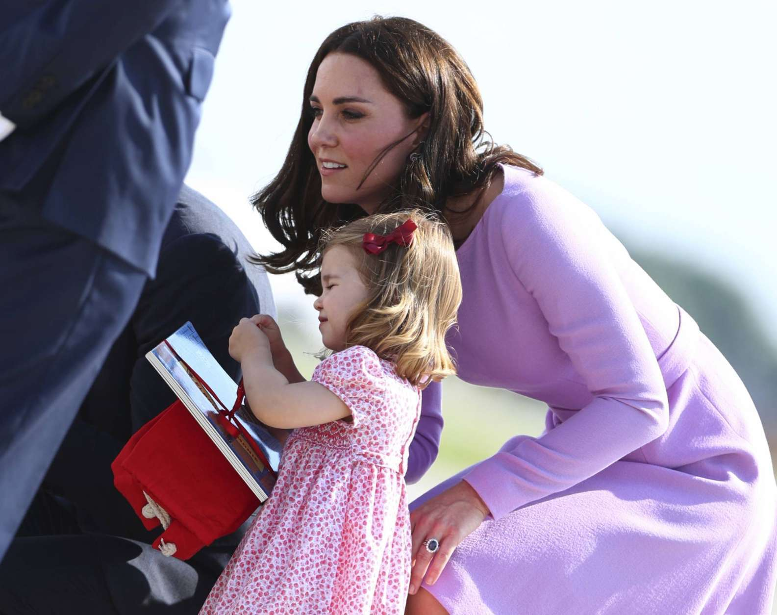 Britain's  Kate,  the Duchess of Cambridge boards a plane with her daughter Princess Charlotte in Hamburg, Germany, Friday, July 21, 2017.  (Christian Charisius/Pool Photo via AP)