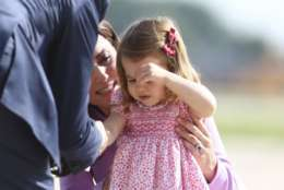 Britain's Kate, the Duchess of Cambridge,  boards a plane with her daughter Princess Charlotte in Hamburg, Germany, Friday, July 21, 2017.  (Christian Charisius/Pool Photo via AP)