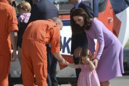 Britain's  Prince William and Kate the Duchess of Cambridge, right, and their children Charlotte,  second right and George, second left,  inspect  a helicopter during their visit to Airbus in Hamburg, Germany, Friday, July 21, 2017.  (Christina Sabrowsky/dpa via AP)